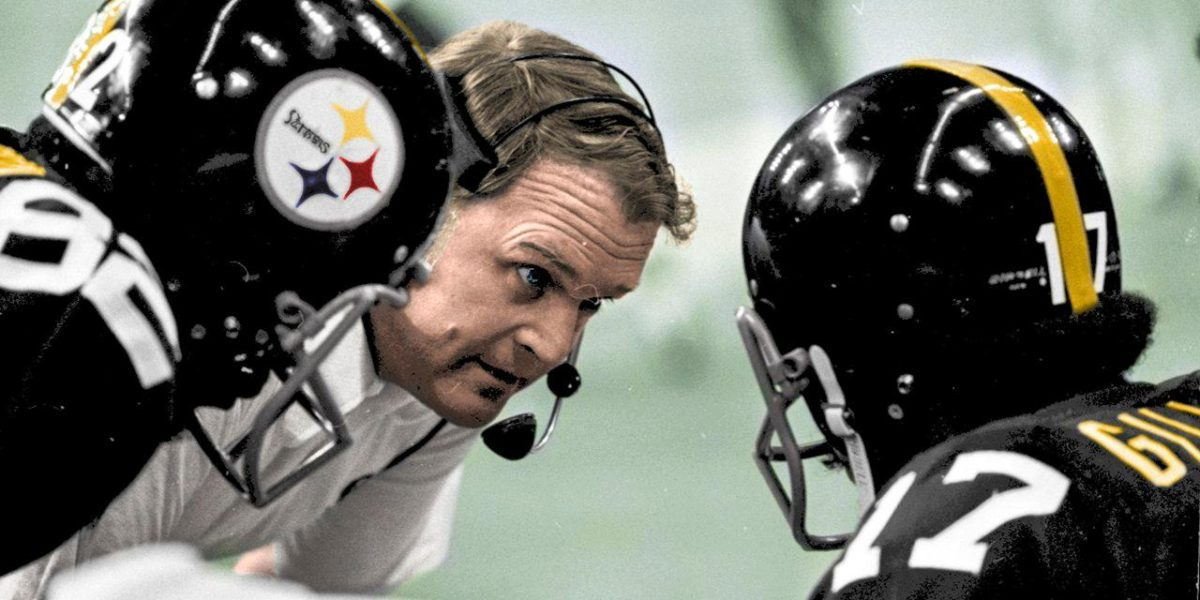 Former Steelers head coach Chuck Noll coaches his players