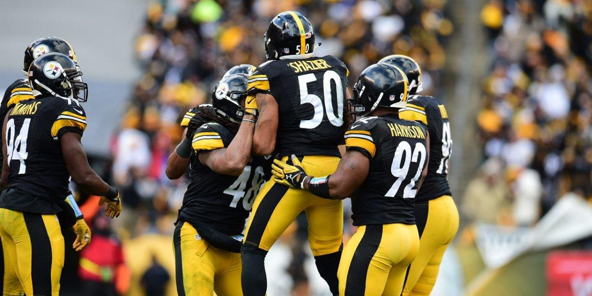 Pittsburgh Steelers linebackers celebrate after a turnover
