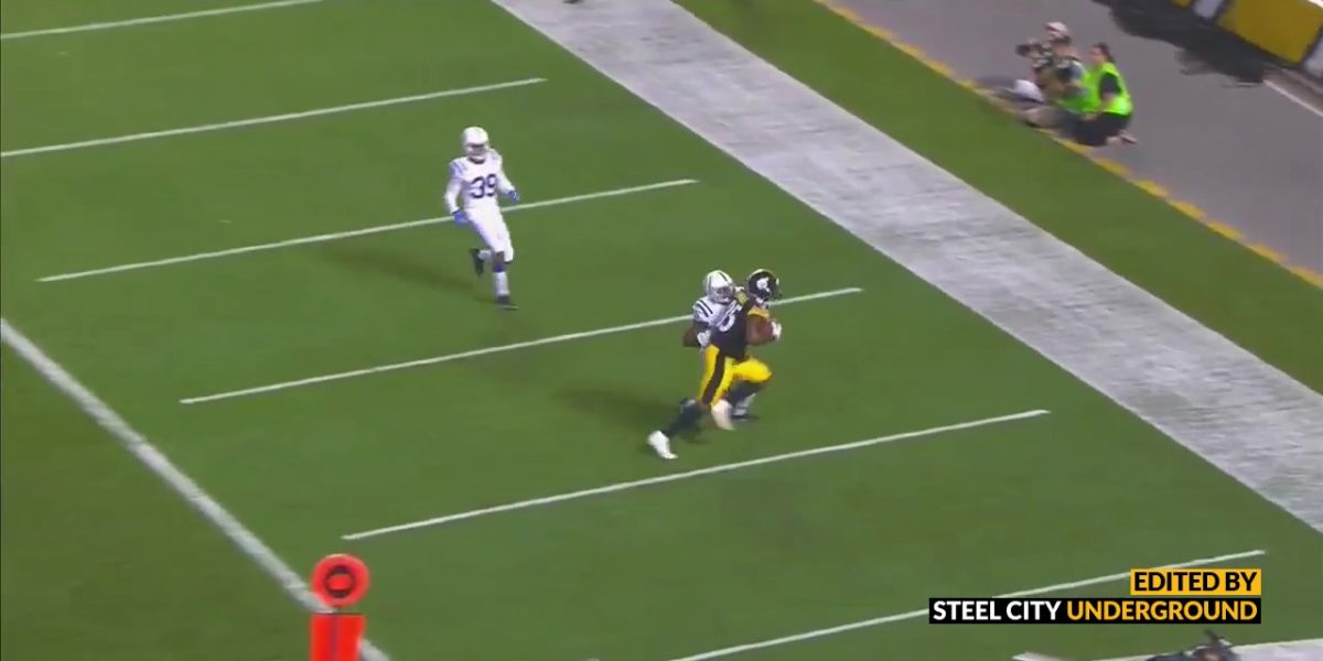 Xavier Grimble catches a touchdown pass against Colts
