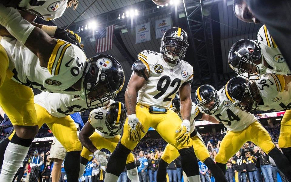 James Harrison #92 leads the Steelers in a pre-game pep talk ahead of playing the Detroit Lions