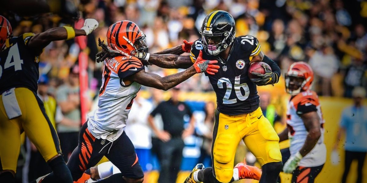 Steelers running back Le'Veon Bell stiff arms Bengals defensive back Dre Kirkpatrick