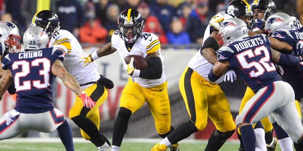Steelers running back Le'Veon Bell rushes against the New England Patriots in the AFC Conference Championship