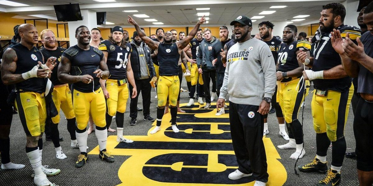Steelers head coach Mike Tomlin addresses the team after their win over the Green Bay Packers
