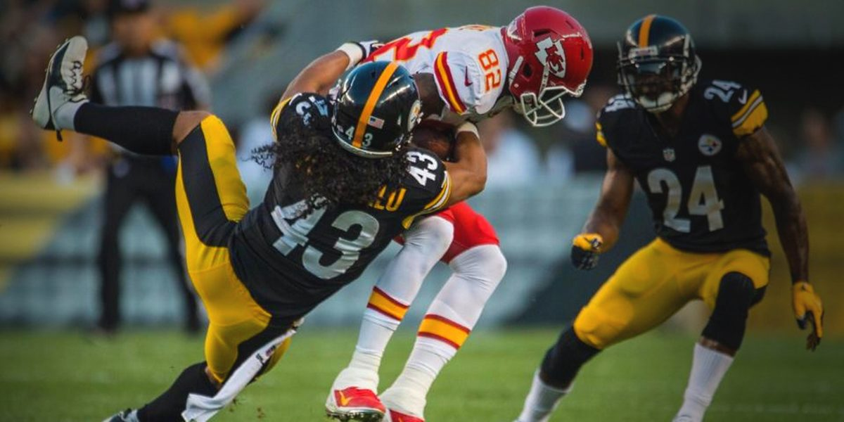 Steelers safety Troy Polamalu makes a tackle on a Kansas City Chiefs receiver during the 2013 NFL season