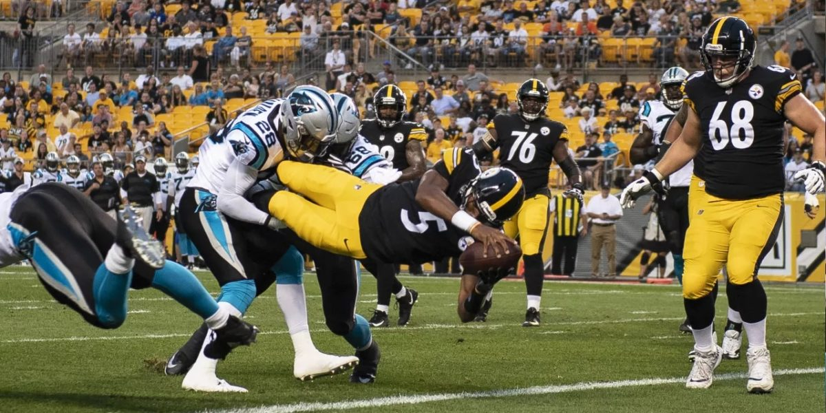 Quarterback Joshua Dobbs of the Pittsburgh Steelers leaps in the end zone against the Carolina Panthers during the 2018 NFL preseason
