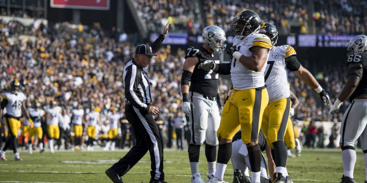 NFL referee spots the ball during Steelers/Raiders game