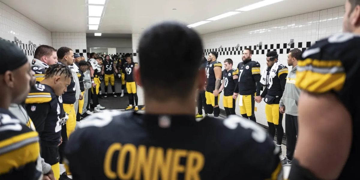 The Pittsburgh Steelers are led in pregame prep by quarterback Ben Roethlisberger in the Pittsburgh locker room on Dec. 20, 2018