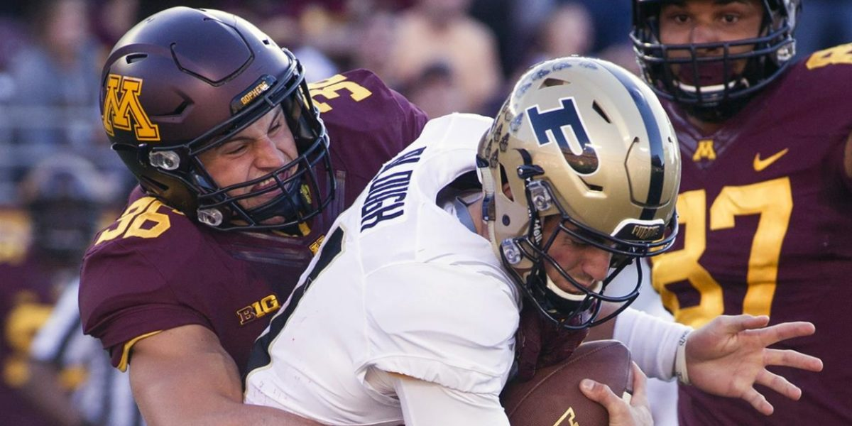 Minnesota Golden Gophers linebacker Blake Cashman makes a sack against the Purdue Boilermakers