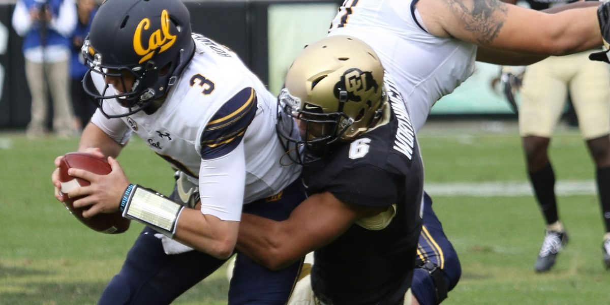 University of Colorado safety Evan Worthington makes a sack against Cal