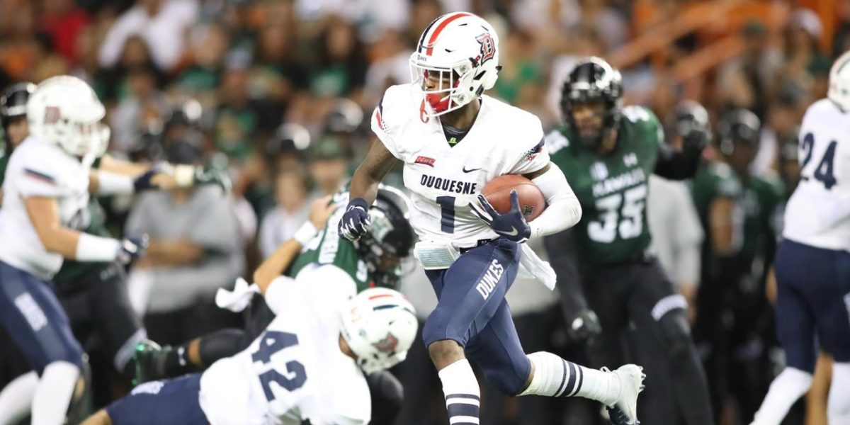 Duquesne University receiver Nahari Crawford runs a catch for a touchdown