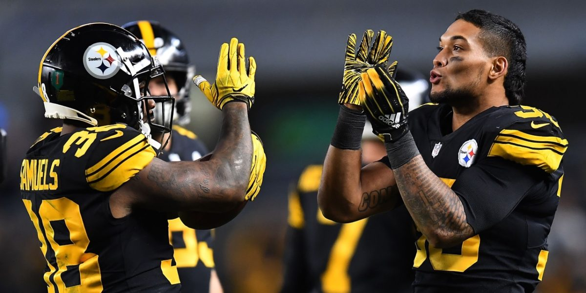 Pittsburgh Steelers running backs James Conner and Jaylen Samuels celebrate on the sidelines