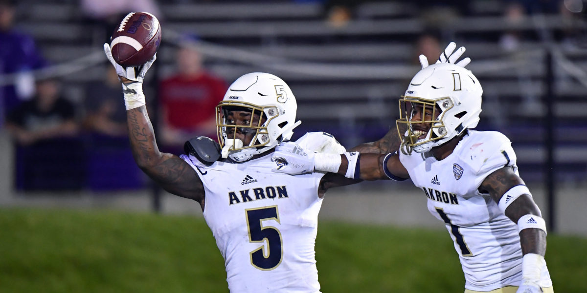 Akron Zips linebacker Ulysees Gilbert III (5) react after scoring a touchdown on a fumble recovery in the second half against the Northwestern Wildcats at Ryan Field. Mandatory Credit: Quinn Harris-USA TODAY Sports