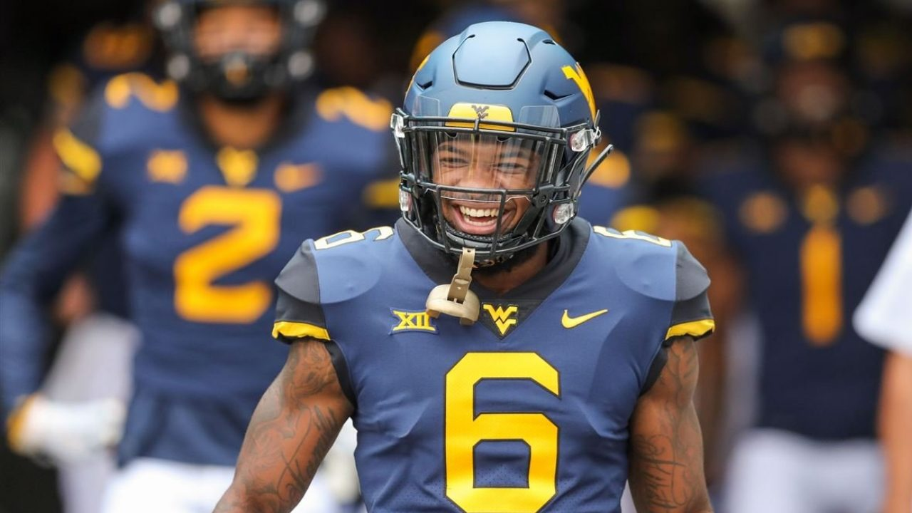West Virginia Mountaineers safety Devon Askew-Henry runs onto the field before a game in 2018