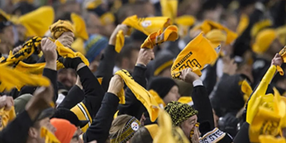 Pittsburgh Steelers fans wave their cherished 'Terrible Towels' at Heinz Field during an NFL playoff game