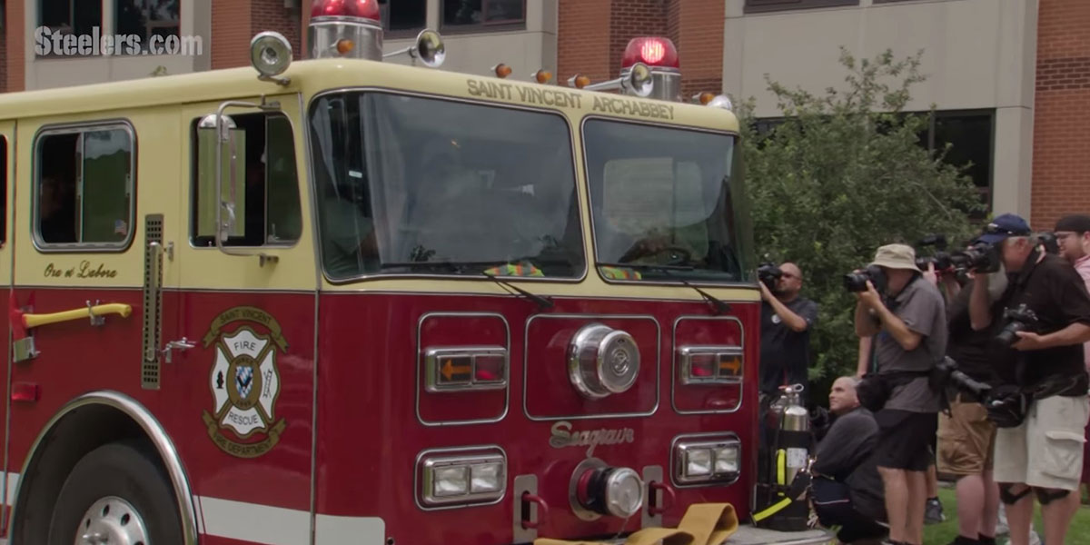 James Harrison arrives to training camp on a fire truck