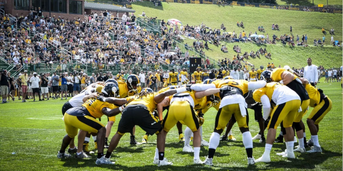 The Pittsburgh Steelers huddle at Chuck Noll Field