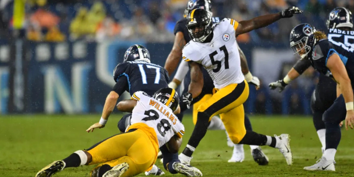 Pittsburgh Steelers outside linebacker Tuzar Skipper joins Vince Williams in bringing down the Tennessee Titans during preseason 2019