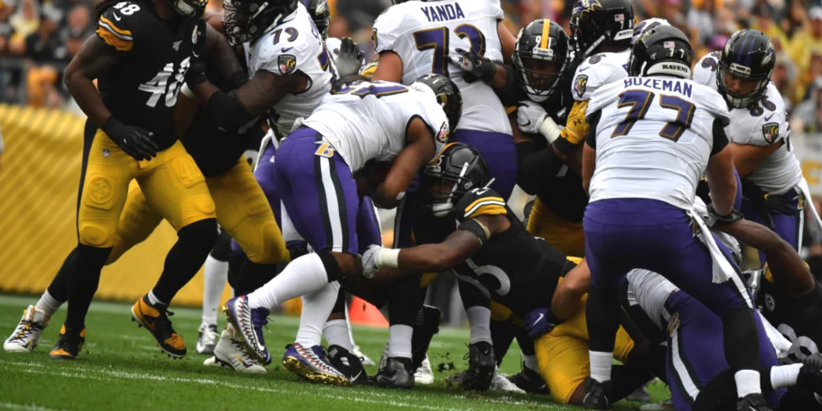 Pittsburgh Steelers rookie linebacker Devin Bush makes a tackle against the Baltimore Ravens in NFL Week 5 of the 2019 season
