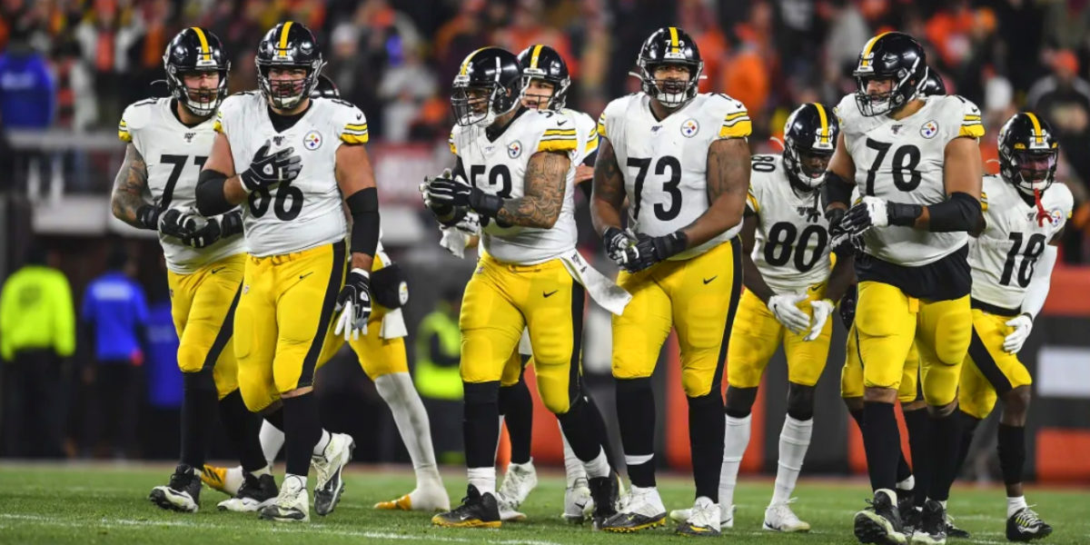 The Pittsburgh Steelers offense lines up to run a play against the Cleveland Browns in Week 11 of the 2019 NFL regular season