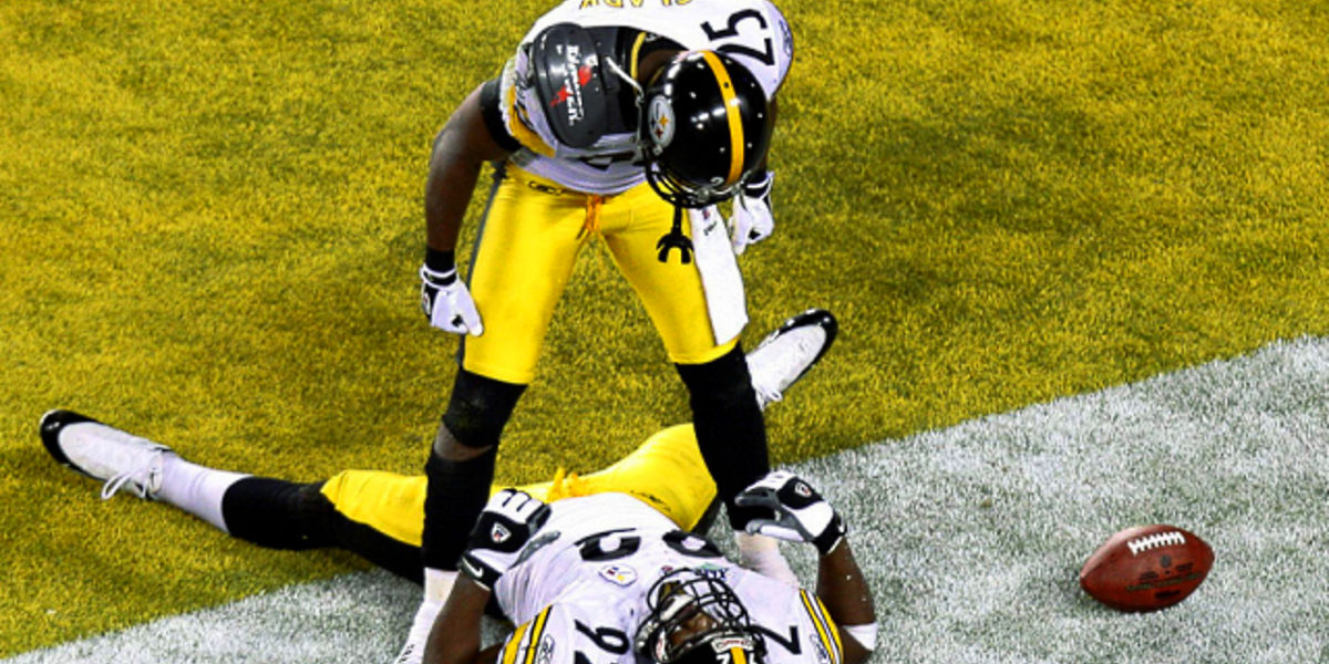 Pittsburgh Steelers defensive back Ryan Clark celebrates with teammate James Harrison
