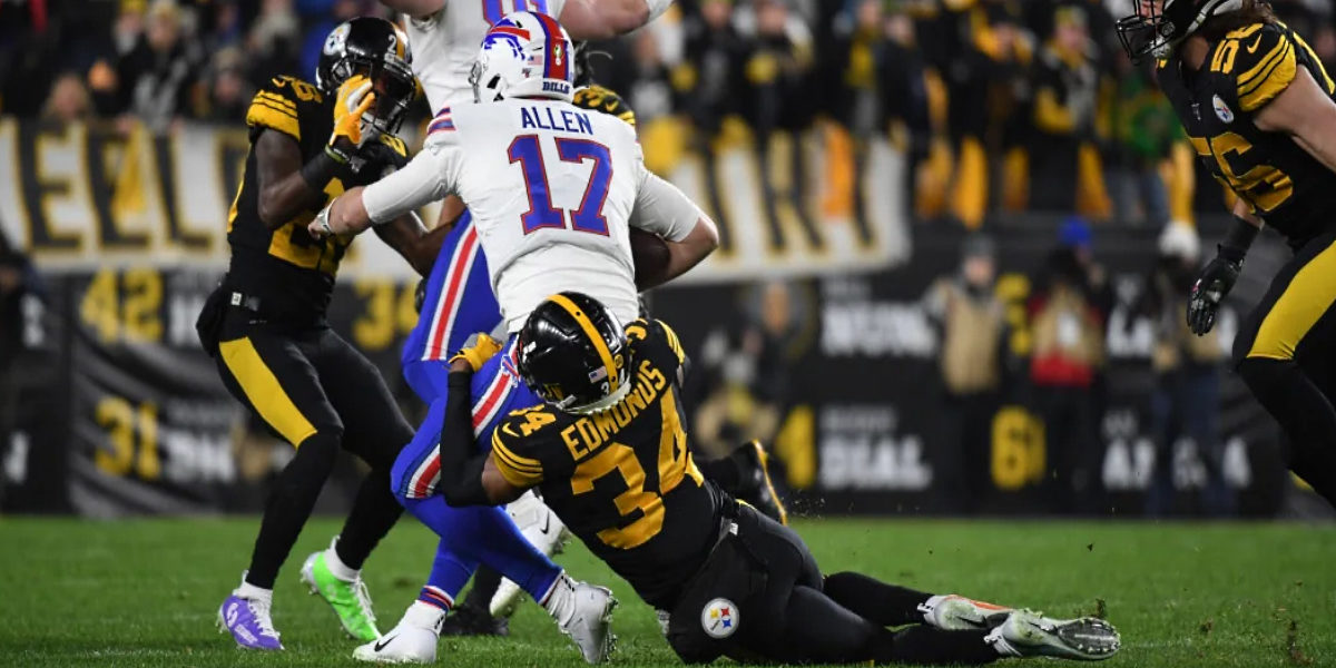 Pittsburgh Steelers safety Terrell Edmunds tackles Buffalo Bills quarterback Josh Allen during Week 15 of the 2019 NFL regular season