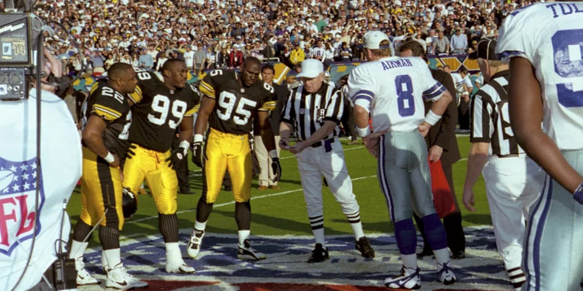 The Pittsburgh Steelers and Dallas Cowboys prepare for the coin toss to open Super Bowl XXX
