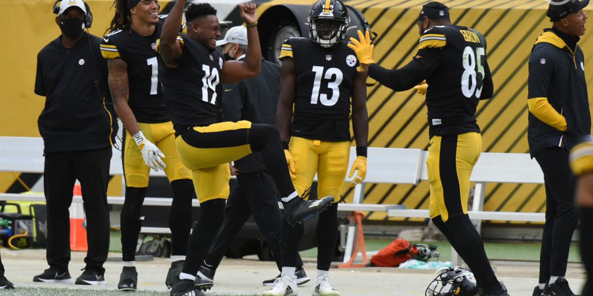 Steelers receiver JuJu Smith-Schuster celebrates a win with his teammates over the Browns