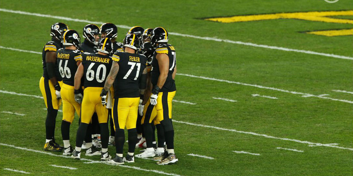 Pittsburgh Steelers center J.C. Hassenauer (#60) huddles up